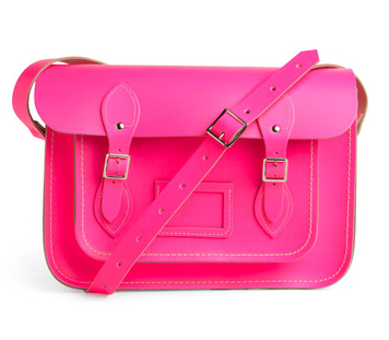This ultra stunning, neon pink satchel, designed by The Cambridge Satchel Company in the UK, is absolutely saturated with style. From its sturdy, super smooth, genuine leather composition, to its long, adjustable shoulder strap, this versatile bag is much like a clearly outlined thesis or a well-written proposal - straightforward, uncompromising, and worthy of endless applause! When you undo the sleek silver hardware of this bag's traditional, double-buckle front, you'll be pleased to discover a spacious inner pocket with just enough room to store your school books, notebooks, and wallet. A smaller compartment, with the additional embellishment of a sewn-in luggage tag for ultimate personalization, adorns the front. The contrasting white stitching at this bag's perimeter only heightens the feel of sassy charm that you'll surely cultivate when carrying this satchel between classes, or to and from the office. Pair with high-waisted trousers, a geometric-print blouse, silver necklaces, and a classic fedora for a fashion-forward ensemble teeming with polished panache.$139.99